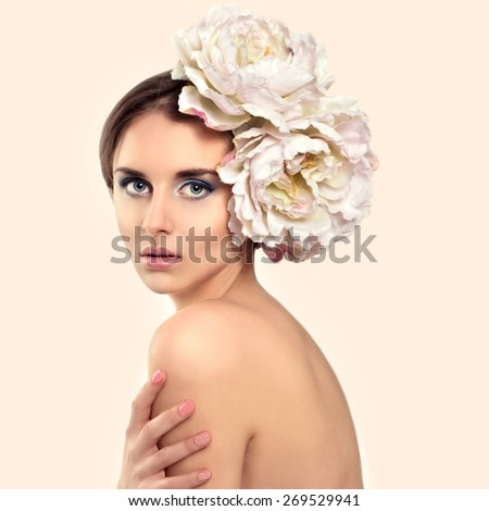 Beautiful Young Woman Model with Flower in her Hair. Vogue Style. - stock photo