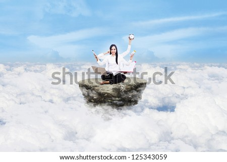 Beautiful young woman multitasking over clouds under blue sky - stock photo