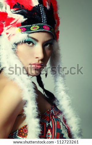 Beautiful young woman native American Indian, isolated on white background - stock photo