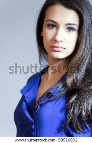 Beautiful young woman of multiple ethnicity in a glamour pose with high key lighting.