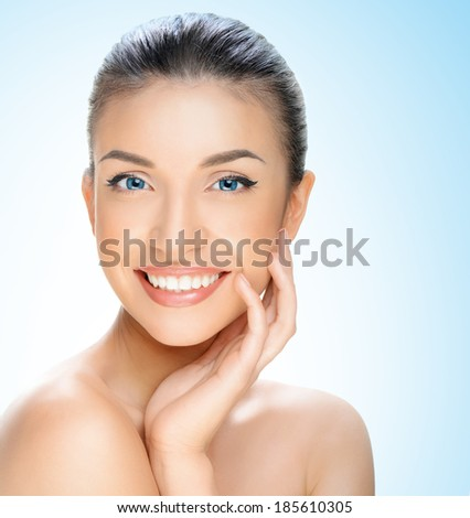 beautiful young woman on a blue background, beauty concept - stock photo