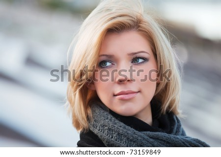 Beautiful young woman on a city street - stock photo