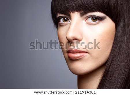 Beautiful young woman  on a gray background - stock photo