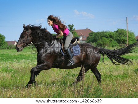 beautiful young woman on a horse - stock photo