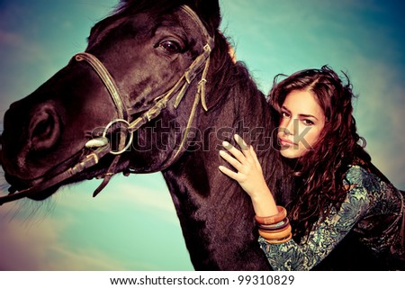 beautiful young woman on a horseback, outdoor portrait