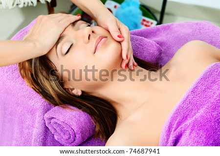 Beautiful young woman on a massage at a salon. Beauty, healthcare. - stock photo