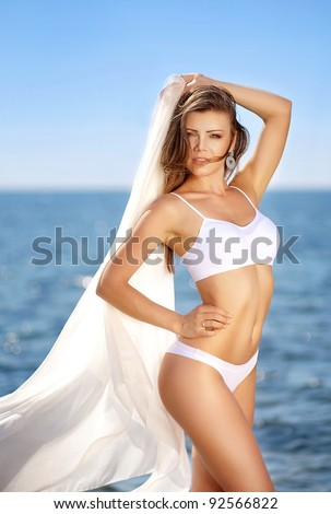 beautiful young woman on a tropical beach - stock photo