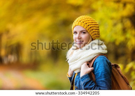 Beautiful young woman on a walk in autumn forest