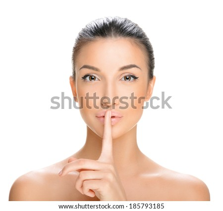 beautiful young woman on a white background, beauty concept ,finger on lips. - stock photo