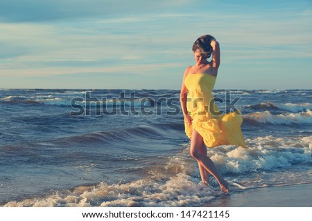 beautiful young woman on beach - stock photo