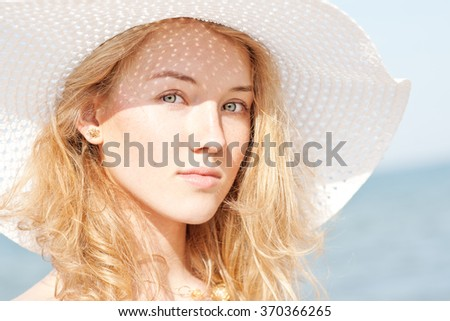 Beautiful young woman on beach- sunny summer portrait