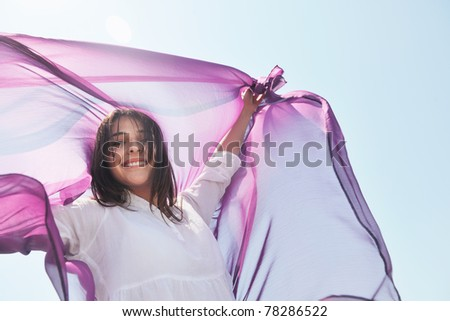 beautiful young woman on beach with scarf relax smile and have fun - stock photo