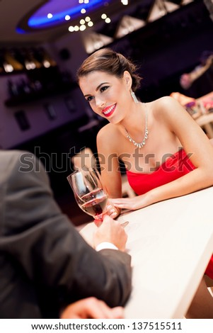 Beautiful young woman on dating with her boyfriend in restaurant - stock photo