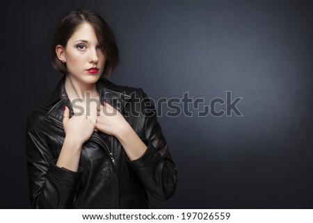 Beautiful young woman on gray background  - stock photo