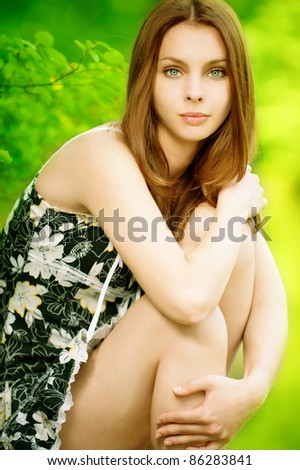 beautiful young woman on green background