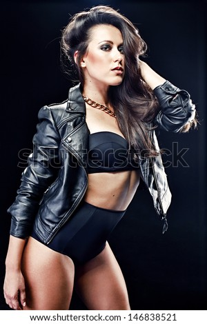 Beautiful young woman on leather jacket - stock photo