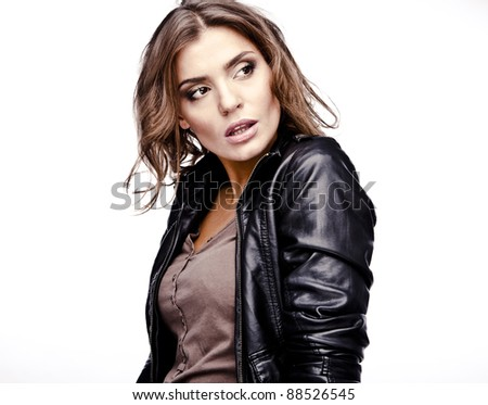 Beautiful young woman on leather jacket. - stock photo