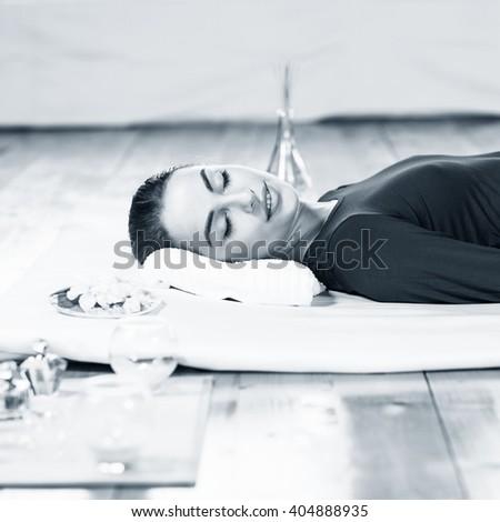 Beautiful young woman on massage - stock photo