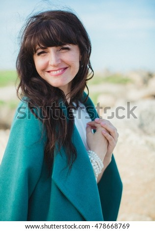 Beautiful young woman on nature