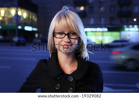 Beautiful young woman on night street, close-up.