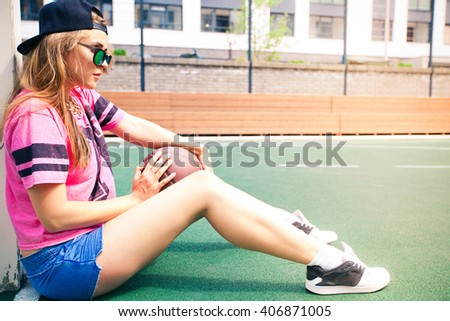 Beautiful young woman on the basketball court - stock photo