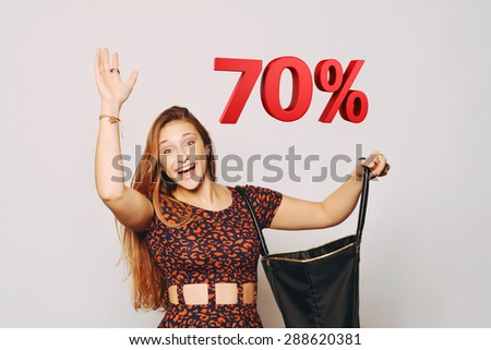 beautiful young woman opening a bag with a 70 percent discount in 3D. Sale concept. - stock photo