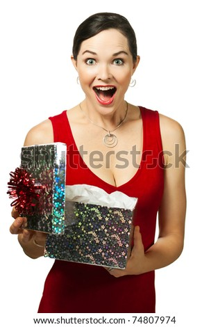 Beautiful young woman opening gift box looking very excited - stock photo