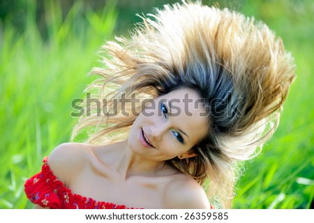 beautiful young woman outdoor - stock photo