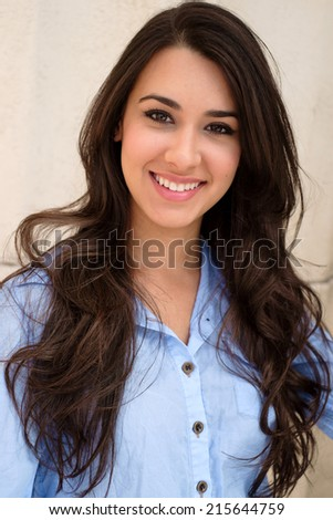Beautiful young woman outdoor portrait. - stock photo
