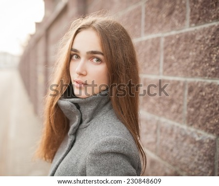 beautiful Young woman outdoors close-up portrait.