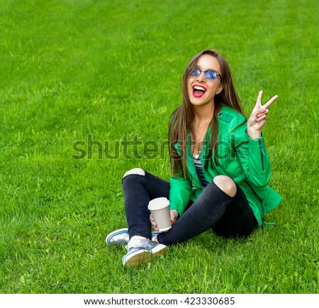 Beautiful Young Woman Outdoors. Enjoy Nature. Healthy Smiling Girl in Green Grass. Fashion woman in sunglasses outdoor. - stock photo
