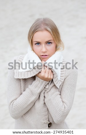 Beautiful young woman outdoors, feeling cold. - stock photo