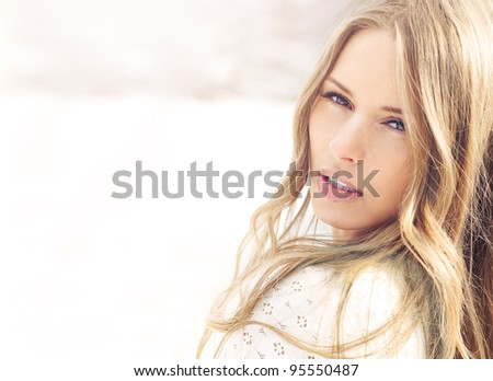 beautiful young woman outdoors on a bright sunny day - stock photo