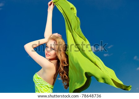 Beautiful young woman outdoors over blue sky. - stock photo