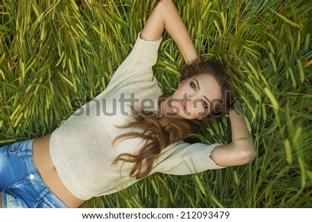beautiful Young woman outdoors portrait. - stock photo