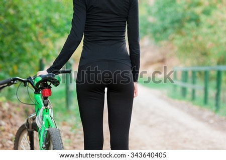 beautiful Young woman outdoors portrait with bike - stock photo