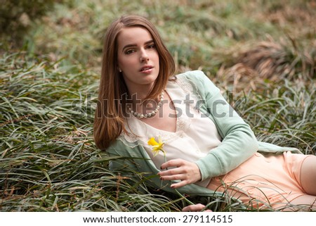 Beautiful Young Woman Outside With Flower
