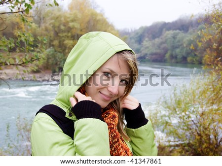 Beautiful young woman over late autumn background