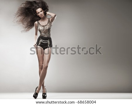Beautiful young woman over white background - stock photo