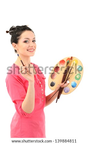 Beautiful young woman painter with brushes and palette, isolated on white - stock photo