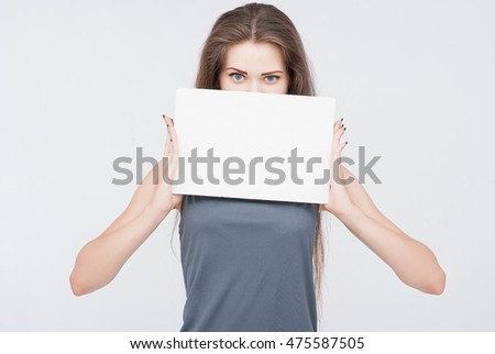 Beautiful young woman photographed in studio against white background.