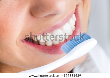beautiful young woman picking his teeth - stock photo