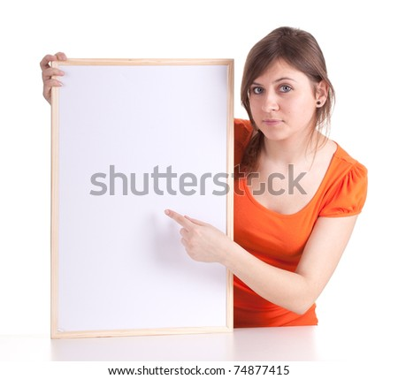 beautiful young woman pointing on blank sign, billboard - stock photo