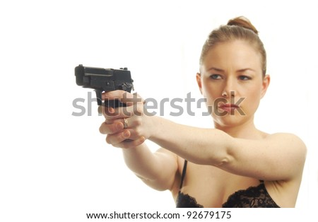 beautiful young woman pointing pistol - stock photo
