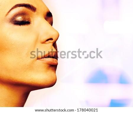 Beautiful young woman - Portrait at salon - stock photo