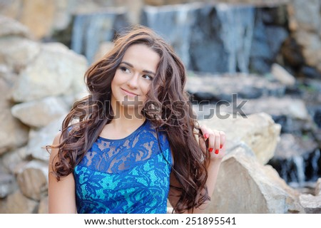 Beautiful young woman portrait, close up outdoor. - stock photo