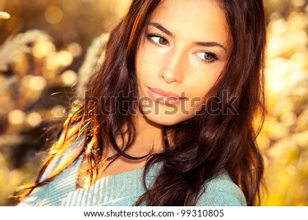 beautiful young woman portrait, close up outdoor - stock photo