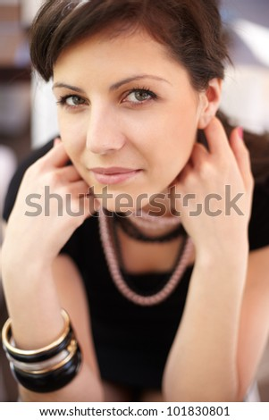beautiful young woman portrait, close up outdoor.With pearls necklace - stock photo