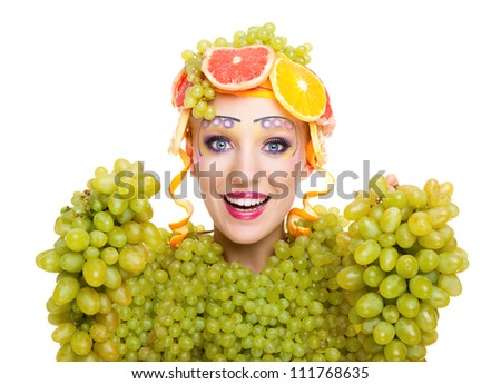 beautiful young woman portrait excited smile with fantasy art hair makeup style, fashion girl with creative food fruit orange, grapes, citrus make up, happy looking at camera isolated white background - stock photo