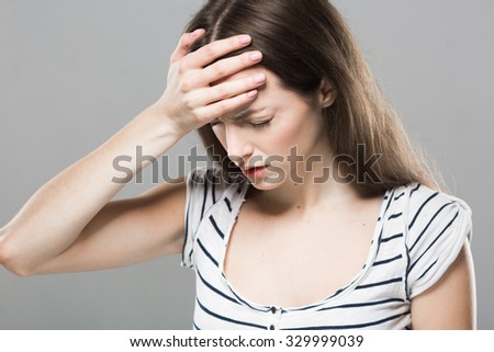 Beautiful young woman portrait Headache depression stressed tired - stock photo